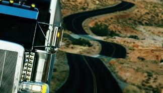Semi-truck on winding desert highway