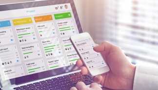 Manager working with agile framework board for lean product development such as scrum or kanban methodology, project management with iterative or incremental strategy, smartphone and laptop in office